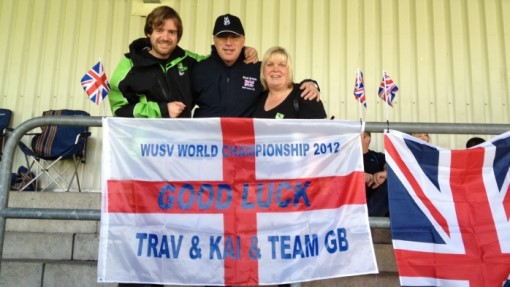 Head dog trainer Travis Foster with good luck flag