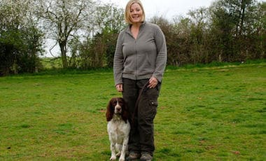 lorraine with dog sitting obediently