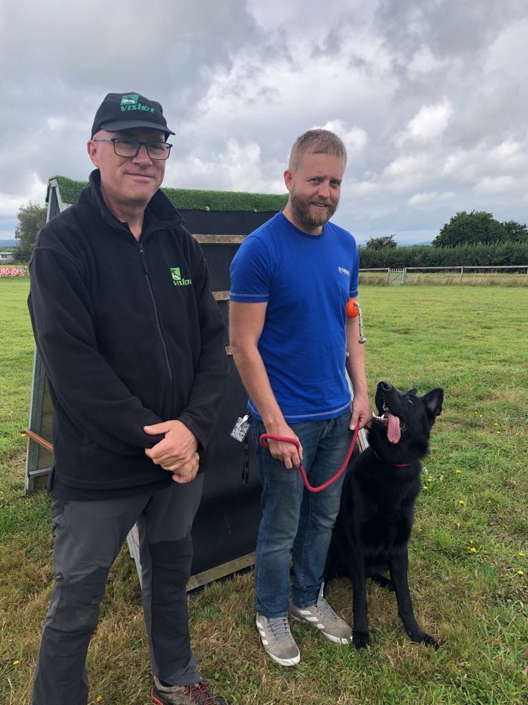 Travis Foster with John B and his dog Bailey having one to one training at Vislor Dog Training Center - West Midlands